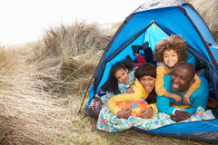 Young Family Relaxing Inside Tent On Holiday. Young Family Relaxing Inside Tent On Camping Holiday royalty free stock photos