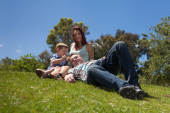 Young family relaxing outdoors Stock Image