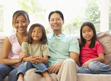 Young Family Relaxing On Sofa At Home Stock Images