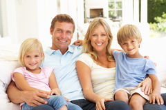 Young Family Relaxing Together On Sofa Royalty Free Stock Images