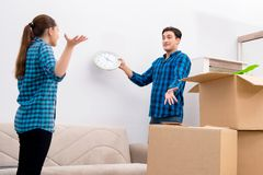The young family relocating to new house apartment. Young family relocating to new house apartment Stock Image