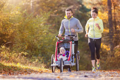 Young family running Royalty Free Stock Images