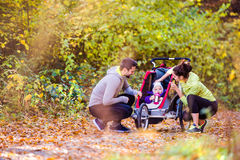 Young family running Royalty Free Stock Image