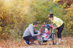 Young family running Stock Photography