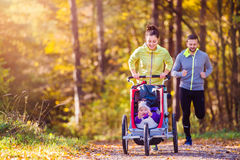 Young family running Stock Image