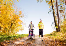 Young family running Royalty Free Stock Photos