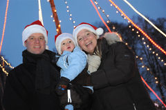 Young Family with santa hats Royalty Free Stock Images