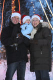 Young Family with santa hats Royalty Free Stock Photos