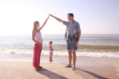 Young family  by the sea. Young family stands as a house by the sea Stock Photo