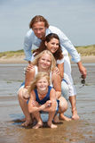 Young family by the seaside. Attractive young family by the seaside enjoying the summer Stock Image