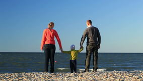 Young family at the seaside Royalty Free Stock Images