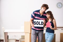 The young family selling their house. Young family selling their house royalty free stock images