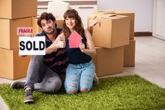 The young family selling their house. Young family selling their house royalty free stock image