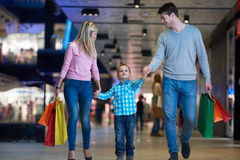 Young family with shopping bags Stock Image