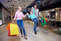 Young family with shopping bags Stock Images