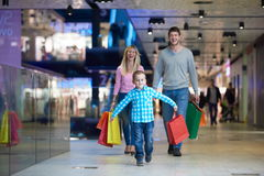 Young family with shopping bags Stock Photography