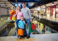 Young family with shopping bags stock photo