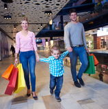 Young family with shopping bags royalty free stock photography