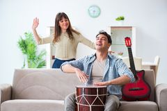 The young family singing and playing music at home Royalty Free Stock Photos