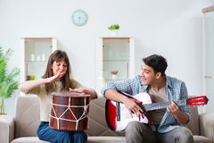 The young family singing and playing music at home Stock Photo