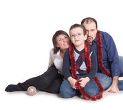 A young family sits on the floor with her son. A men sits on the floor with her son Royalty Free Stock Photo