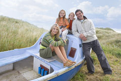 Young family sitting in boat Stock Photography
