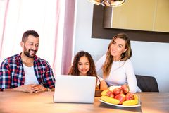 Young family sitting at the table Stock Photo