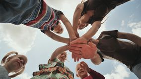 A young family of six join hands together. The concept of a strong and friendly family. stock footage