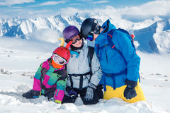 Young family in ski outfit Royalty Free Stock Photo