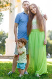 Young family with small child in park Stock Photo