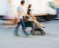 Young family with small child in the  stroller Stock Photography