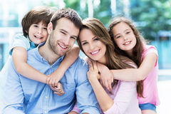 Young family smiling Royalty Free Stock Photos
