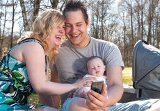 Young family is smiling while taking a selfie Stock Photos