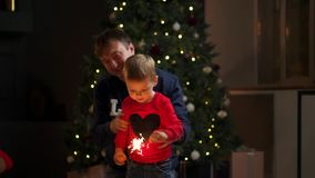 Young family with sparklers at Christmas time at home. stock video