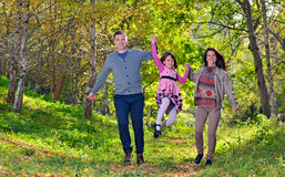 Young family spending time outdoor. Happy young family spending time outdoor stock photography
