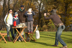 Young family spending time on a picnic with friends Stock Photo