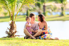 Young family spending time in a tropical garden Stock Images