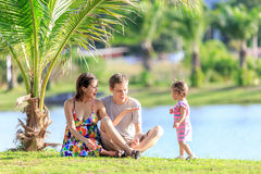 Young family spending time in a tropical garden Stock Photography