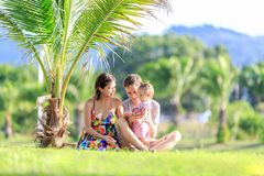 Young family spending time in a tropical garden Stock Image