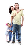 Young family are standing in embrace stock images