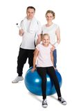 Young family standing in fitness outfit Stock Image
