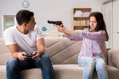 The young family suffering from computer games addiction Stock Photo