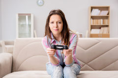 The young family suffering from computer games addiction Stock Photography