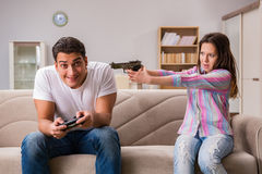 The young family suffering from computer games addiction Stock Photos