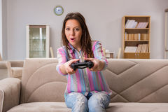 The young family suffering from computer games addiction Royalty Free Stock Images
