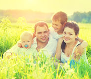 Young family in summer park Royalty Free Stock Photography