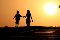 Young family at sunset Royalty Free Stock Photo