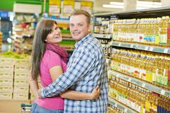 Young family in supermarket Stock Photo