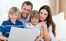 Young family surfing the internet Royalty Free Stock Photo