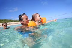 Young family swimming together in the sea Royalty Free Stock Photo